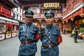 Tourist police fang bang zhong lu old city shanghai china april two policemen posing and smiling in at the of in on Royalty Free Stock Photography