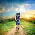 Tourist on the road man with a backpack walking a country Royalty Free Stock Photo