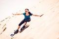 Tourist Sandboarding In The Desert Royalty Free Stock Photo