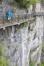 Tourist at scary footpath around cliffs in tianmen mountain china standing the famous and circling high and steep Royalty Free Stock Photos