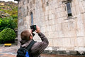 Tourist shooting landmark by smartphone katoghiken church of medieval geghard monastery in armenia Stock Photos