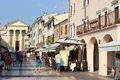 Tourist shops in piazza matteotti bardolino italy view along pedestrianised street to the church chiesa dei ss nicolo e severo the Stock Photo