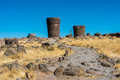 Tourist silustani tombs in the peruvian andes at puno peru Stock Photos