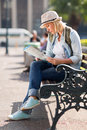 Tourist sitting alone in the city and looking at a map Royalty Free Stock Image