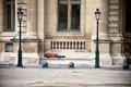 Tourist sleeping on a bench outside the louvre museum in paris lonely man france Royalty Free Stock Photo