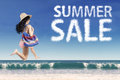 Tourist with summer sale cloud at beach Royalty Free Stock Photo