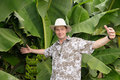 Tourist surprised on banana plantation Royalty Free Stock Images