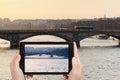 Tourist taking photo of bridge in Paris on sunset Royalty Free Stock Photo