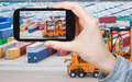 Tourist taking photo of freight containers in port travel concept copenhagen cargo on mobile gadget Stock Image