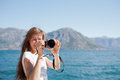 Tourist taking a photograph Royalty Free Stock Images