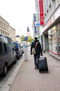 Tourist on tampere street walking with large luggage the streets of finland Royalty Free Stock Images