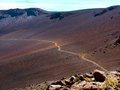 Tourist trail crossing a valley near haleakala volcano desert maui hawaii Royalty Free Stock Photo