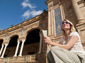 Tourist viewing ornate building in Plaza de Espana, Seville, Spain Royalty Free Stock Photo
