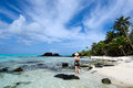Tourist visit tropical island in aitutaki lagoon cook islands woman explores the nature and landscape of Royalty Free Stock Images