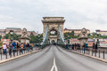 Tourist walk along chain bridge budapest hungary sep in budapest hungary on september it s the first permanent across the Stock Photos