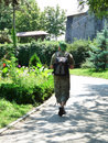 image photo : Tourist walking in public garden