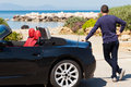 Tourist watching the beach man with black sport car Royalty Free Stock Photography