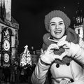 Tourist woman at Christmas in Prague showing heart shaped hands