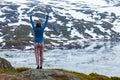 Tourist woman enjoying mountain landscape in Norway