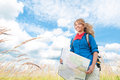 Tourist woman with map in summer field. Stock Photo