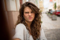 Tourist woman in the street on selfie shot showing gloomy face. Royalty Free Stock Photo