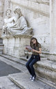 Tourist young girl with map in roma sitting on the stairs background statue square venice rome italy Royalty Free Stock Image