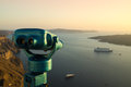 Touristic binoculars overlooking sea with cruise liners during sunset santorini greece Stock Images