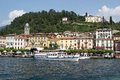 Touristic boat on the como lake with bellagio village in the background italy Royalty Free Stock Photos