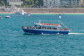 Touristic boat in the ocean small during a sunny day with other moored san sebastian spain Royalty Free Stock Photography
