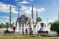 Tourists admiring the view of the fountain and blue mosque sultanahmet camii in istanbul turkey Royalty Free Stock Photography