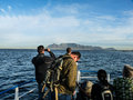 Tourists approaching cape town harbour on a boat approach the Royalty Free Stock Photography