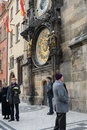 Tourists at the astronomical clock on the old town hall.