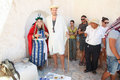 Tourists at berber home matmata tunisia september couple dressed in a s clothing with a group of in front of a troglodyte tasting Royalty Free Stock Photography