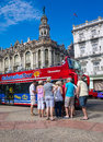 Tourists boarding a sightseeing bus in Havana Royalty Free Stock Images