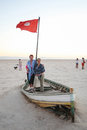 Tourists on a boat at salt lake Chott El Jerid Royalty Free Stock Photo