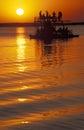 Tourists on a boat at sunset, Botswana. Royalty Free Stock Photo