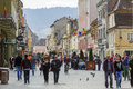 Tourists in brasov historic center unidentified stroll and enjoy the sights along republic street on march the th largest and the Stock Image