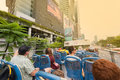 Tourists on bus with open air deck in Kuala Lumpur, Malaysia