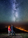 Tourists in camping at night against starry sky Royalty Free Stock Photo