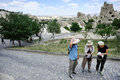 Tourists in cappadocia turkey june looking at guide books the rose valley ancient site on june Royalty Free Stock Images