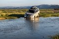 Tourists in cars crossing small river western mongolia mongolia aug foreign Stock Photos