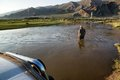 Tourists in cars crossing small river western mongolia mongolia aug foreign Royalty Free Stock Photo