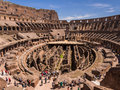 Tourists at the colosseum in rome overview of inside amphitheatre of italy Royalty Free Stock Photo