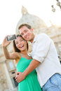 Tourists couple selfie by vatican city in rome and st peter s basilica church happy travel women and men taking photo Stock Image
