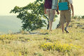 Tourists couple walking in mountain road Royalty Free Stock Photography