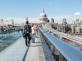 Tourists crossing Millennium Bridge, London, toward St. Pauls Cathedral Royalty Free Stock Photo