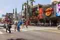 Tourists crossing the street in hollywood los angeles ca usa th may people front of a famous hard rock cafe Stock Photos