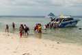 Tourists descend from the boat to the shore adaman sea thailand Royalty Free Stock Photography