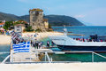 Tourists descend from the ship in port of ouranoupoli greece ouranoupolis june under greek flag ouranoupolis harbor athos Stock Image