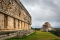 Tourists enjoying a cloudy day at the Uxmal Ruins in Mexico. Royalty Free Stock Photo